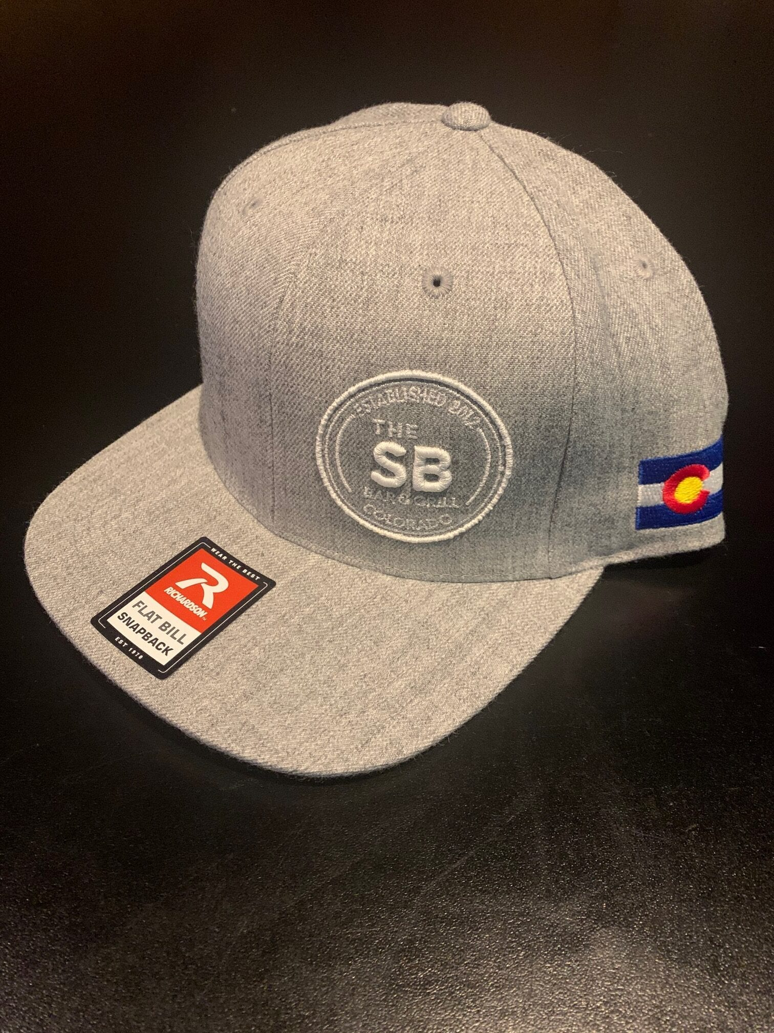 Grey snapback with Colorado logo and white badge